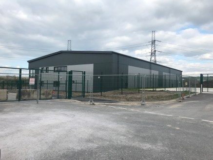 The property comprises of a proposed new unit under construction as follows:  Steel Portal Frame  Profile Steel Cladding  Attractive Curtain Walling  Glazing to the office entrance  8 Metre Eaves  Floor Loading 60 KN per sq.m  Specific tenant's requi...