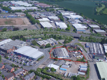 The site is currently arranged to provide a circa 16,000 sq ft industrial unit that has been sub-divided to currently provide four units. The existing buildings occupy approximately 25% of the site, with the remaining land being level hard standing t...