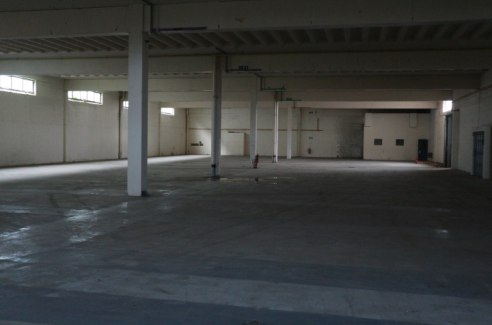 Prominent warehouse with large loading door