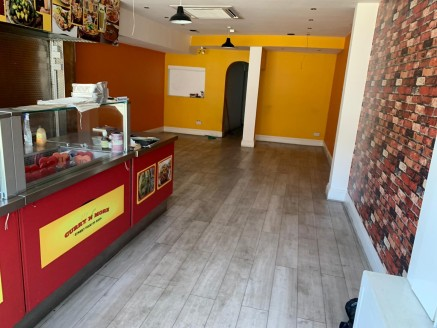 A lock-up A3/A5 hot food takeaway unit which is currently fitted with an open display counter kitchen, an area for seating, prep room, further catering kitchen with full extraction and WC. The overall area is approximately 768 sq ft. The restaurant i...