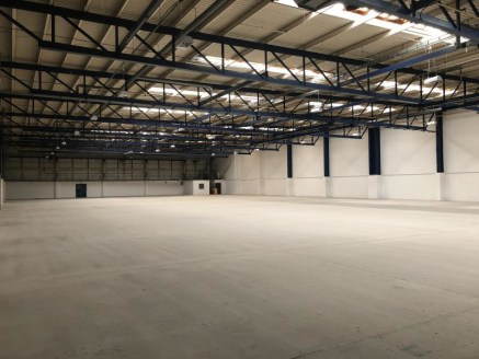 The property comprises a modern warehouse/industrial unit forming part of a well-maintained commercial estate. It is of steel frame constriction beneath a steel profile clad roof surface incorporating translucent sky lights. The building briefly bene...