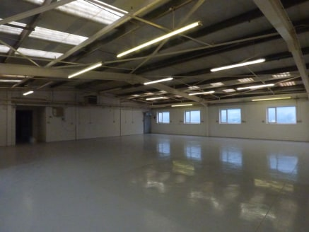 The property comprises a modern double storey warehouse premises of steel portal frame construction with brick elevations beneath a pitched steel sheet roof.   The accommodation is largely open plan in layout and provides an element of office accommo...