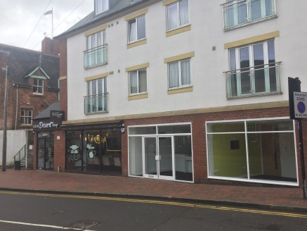 The premIses are sItuated In Stafford town centre on the south sIde of MIll Bank between Its junctIons wIth Greengate Street, BrIdge Street and South Walls. Adjacent to THE LITTLE DESSERT SHOP and close to a major branch of THE ROYAL BANK OF SCOTLAND...