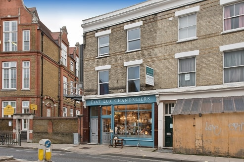 A GROUND FLOOR SHOP & PREMISES (A1), LOOKING ONTO LILLIE ROAD, & 4 FLATS (C3)\n\nOverview\n\nTo Let\n\nAn attractive flat fronted, end of terrace, Victorian building with a glazed ground floor frontage, leading to a retail area and a second retail ar...