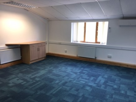 The property comprises first floor self-contained offices within a two-storey detached building. The ground floor is separately let. The accommodation comprises mainly open plan office space with three directors offices with amenities including carpe...