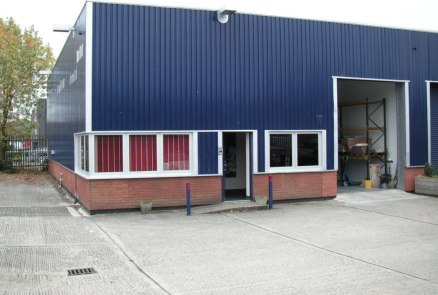 "3,403 sq ft\n\nWorkshop / Warehouse\n\nWarehouse\n\n* 3 phase power supply\n\n* Motorised roller shutter door, 9'10"" wide x 13' high\n\n* Minimum eaves height 15'6""\n\n* Fluorescent strip lights\n\n* Kitchen\n\n* Male and female WC's\n\n* Reception o..."
