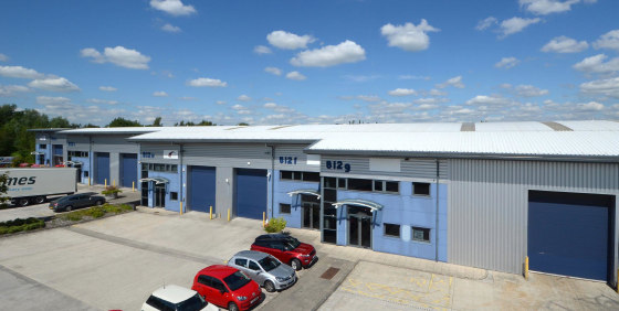 Drive in loading doors. 50kN/sq m floor loading. Eaves height 5.5m. Large concrete loading apron. Consent for B1(c), B2 and B8 uses. Fully fitted office. Cat II lighting. Perimeter trunking. Dedicated car parking.