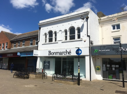 The premises are double-fronted with central in/out doorways. The premises are arranged over ground and first floors. The ground floor is laid out to provide a large, open-plan retail area, together with ancillary storage space behind together with f...