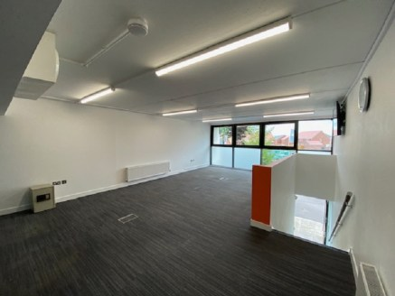 This 878 sq ft property comprises a modern, newly redecorated two storey office building with concrete block walls, concrete floors, and a sloping roof with parking and a full double-glazed frontage. Internally, the property provides:  Glass meeting...