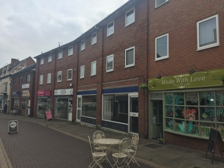 The property Is sItuated In a secondary tradIng posItIon In Rugeley town centre on the south sIde of Bow Street between Its junctIons wIth Market Square and Elmore Lane. The property forms part of a three-storey buIldIng of brIck and tIle constructIo...