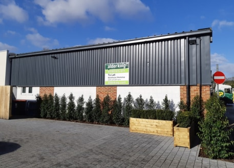 Light industrial unit of clear span concrete roof truss construction with part profile steel cladding and part brickwork elevation under steel clad roof. 4.27m (14') internal eaves height. Loading door and pedestrian door to front. Second double pede...