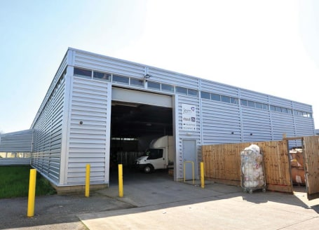 Steel truss construction providing an eaves height of 5.00 - 5.5m. Part brick / part metal clad elevations beneath insulated metal decked roof. Concrete warehouse floor with both heating and sodium lighting. Dedicated parking area to the front provid...