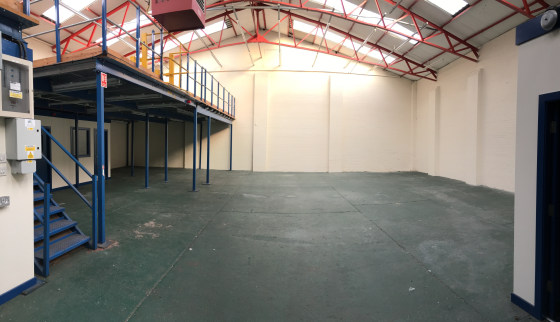 The property comprises a single storey trade counter/industrial unit being constructed on a steel portal frame and clad in plastic coated steel sheeting.  The unit is has an eaves height of approximately 5.4m and a large roller shutter loading door t...
