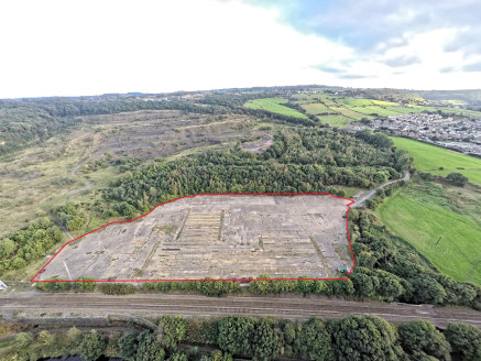The property comprises a substantial rectangular shaped concrete surface site of level topography benefiting from;  Secure gates access  Close proximity to the M62 Motorway Network  Concrete hard surface  The Access to the site is provided via an exi...