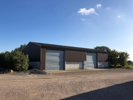 College Farm Barn comprises a single-storey agricultural building. The interior is open plan and benefits from one loading door (4.7m H x 4.88m W). The unit has a height to eaves of 4.54m and ridge height of 6.07m. The premises will benefit from WC's...