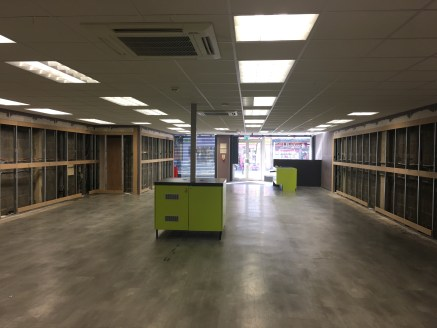 The property comprises the ground floor of a 3 storey mid terrace building.  The ground floor offers a large open plan retail space with ancillary storage and WC to the rear.  The main retail space includes two display windows astride a central doorw...