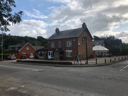Freehold investment/development opportunity for sale in Cotebrook, Tarporley.  A mixed use investment with development potential subject to planning on a site of 0.31 acres.   The site comprises two residential flats, two retail units, two offices an...