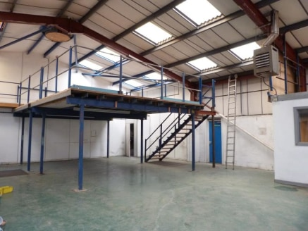The unit is a well presented detached industrial building of modern characteristics, being of steel portal frame construction beneath a pitched, profile clad roof surface incorporating sky lights.\n\nInternally the building comprises a main warehouse...