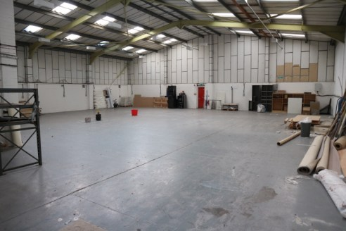 A modern end of terrace industrial / warehouse with large loading door 5.3m clear height and good car parking.