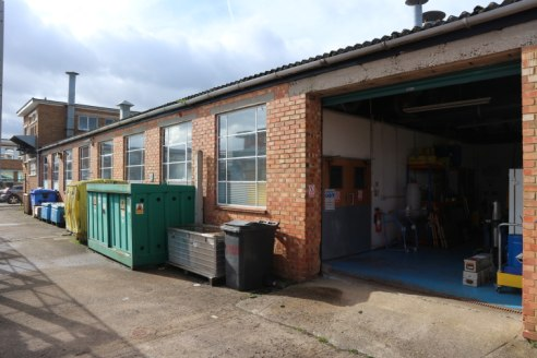 Two semi-detached industrial / warehouse units, each with small securable yards and car parking, available separately or together.