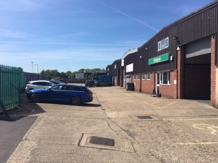 WAREHOUSE UNIT WITH LARGE YARD - TO LET  The property comprises a concrete framed building with profile metal cladding to walls and roof.  Internally the property comprises warehouse space with two storey offices to the front and a further single sto...