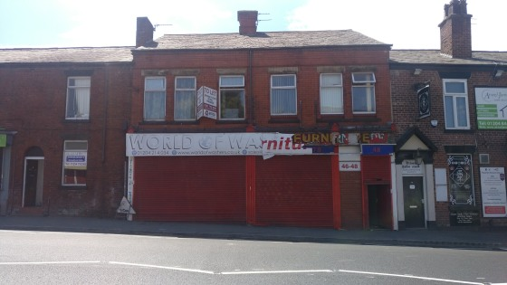 Double fronted retail premises on main road close to the town centre pedestrian precinct in Farnworth, a prominent main road location. Nearby occupiers include travel agent - Thomas Cook, betting shops - BetFred and William Hills, as well as local re...