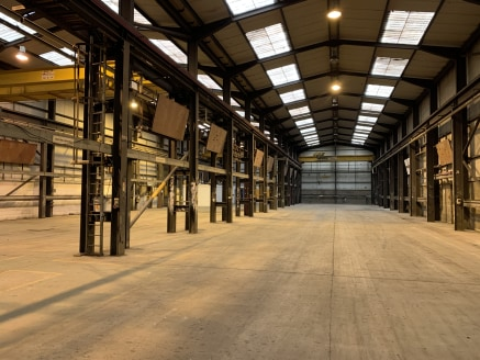 High Bay Workshop/Warehouse Accommodation with Offices  Unit S7 - (23,400 Sq Ft)   Rent - £60,000 per annum  Self-Contained Complex With 24 Hour Manned Security.  Excellent Communication Links to A1.  Flexible Terms.