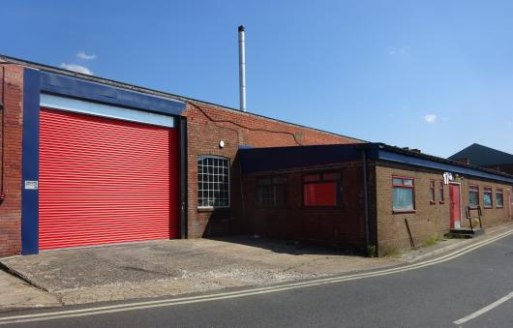 The two bay unit is of steel framed construction with part glazed brick walls surmounted by two pitched, insulated corrugated asbestos roofs incorporating filon roof lights. Height to underside of haunch - 4.65 m. (15'3'') approx. Access is via two r...