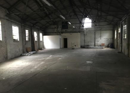 The site comprises a detached single storey industrial unit of brick construction beneath a steel truss framed roof. Internally the unit is of exposed brick masonry walls.   The unit forms an open plan warehouse, with a built-in reception and office...
