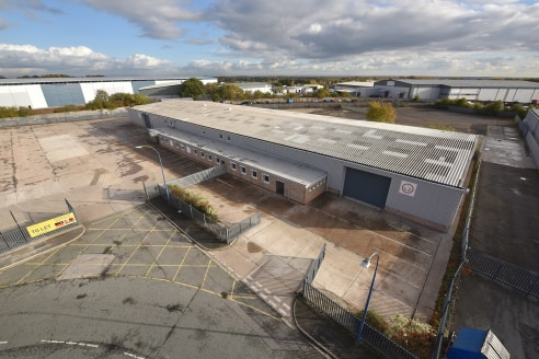 Portal frame construction. Steel profile cladding. Concrete floor. Sodium high bay lighting. All mains services connected. Ground level loading door. Recently refurbished. Two storey office accommodation. Large self-contained secure yard. Option to a...