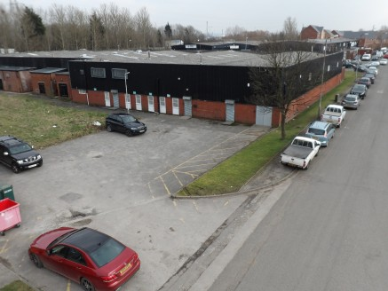 End terraced industrial unit with two storey offices and car parking/yard area.  8,255 sq ft  RENTAL - £24,750