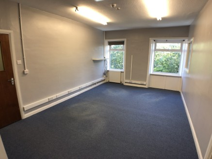 The premises briefly comprise first floor office accommodation set on the main high street running through King Cross on the outskirts of Halifax town centre.  The accommodation is split over three offices with a reception area having paint and plast...