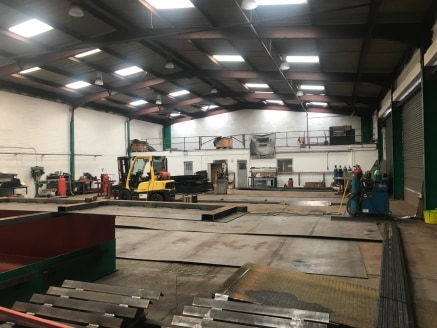 Industrial unit with yard, includes offices and mezzanine.  8,703 sq ft  £36,000 per annum