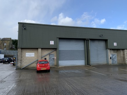 The property comprises a single storey, steel portal framed industrial/ warehouse building in a terrace of similar units, under a sheet metal pitched roof incorporating translucent roof panels. The walls are clad in concrete block and insulated profi...