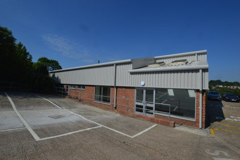 Unit 2 is a detached industrial / warehouse unit of block and steel portal frame construction. The unit benefits from two roller shutter loading doors, two yards, separate offices and staff facilities and prominence to the main London to Brighton rai...