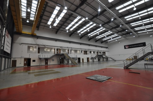 * Ground floor warehouse on secure facility  * Allocated car parking  * To be completely refurbished  * Previously used as aircraft simulator hall