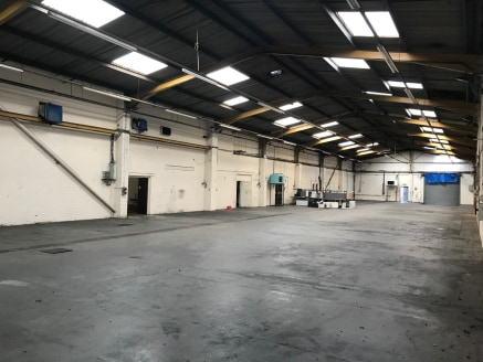 The property comprises of a single bay steel portal framed workshop/warehouse building, with an asbestos cement roof cladded and 10% roof lights  There are offices and staff facilities to the far end of the building. There is a communal yard to the r...