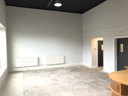The property comprises a single storey detached retail/office premises of brick construction beneath a pitched tiled roof.  Internally, there is an open plan sales area to the front with a separate office, kitchen and WC.  In addition, there are 2 ca...