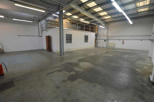 The property comprises an end of terrace industrial unit with profile clad elevations under a pitched roof. The ground floor warehouse benefits from a roller shutter door, a reception / entrance area, kitchen, toilet facilities and an office/studio s...