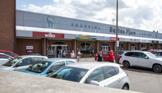 Retail unit to let at Burton Place.   Burton Place occupies a prominent location with a 145,447 shopping population. The centre benefits from 93 adjacent parking spaces and the centre is anchored by Wilko and Home Bargains.  Unit 8C - 390 sq ft - £13...