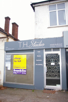 Shop in local parade with parking outside - to let on new lease