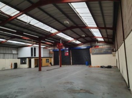 The property comprises of a single storey, two bay warehouse of steel portal frame construction surmounted by a pitched insulated roof incorporating translucent roof lights.\n\nThe property benefits from two large roller shutter entry doors (4.96m x...