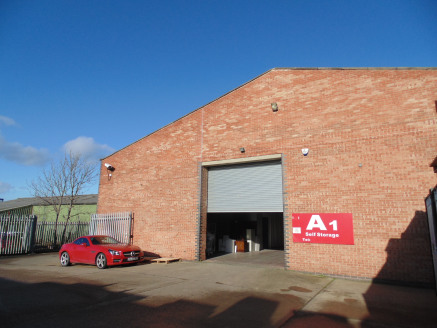 Warehouse with secure service yard. Excellent access to A1(M). Two electric roller shutter doors. 4m eaves height.