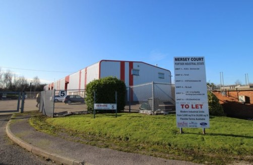 6.5m eaves. Gated site. 200 yards from M53. Short term lease available. External storage space.