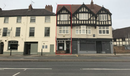 A ground floor retail unit located in a prominent position fronting the main A40 which is a main arterial route into Worcester city centre.  Vacant ground floor retail unit with an occupied two bedroom flat above.