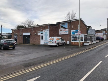 2,902 sq ft\n\nTrade Counter / Industrial / Retail Unit\n\nThe property is an industrial unit with an additional brick two storey unit under a tiled roof and with a modern double glazed conservatory area providing office space. The industrial unit is...