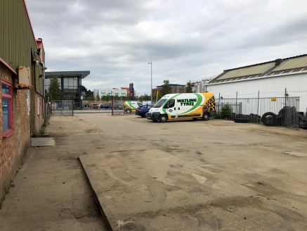 This rectangular site provides level secure concrete hardstanding of some 5,463 sq.ft. within the fenced area, whilst to the front on the outside of the gates adjacent to Victoria Road there is a further area of some 630 sq.ft. Whilst the yard was fo...