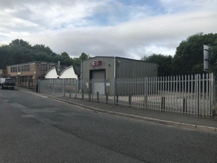 The unit has been constructed with a pre-cast concrete roof and benefits from strip lighting throughout. The unit benefits from a portal frame loading bay and has roller shutter vehicular access at the front and rear of the site....
