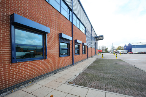 Modern, detached warehouse. Steel portal frame construction. 8.2m eaves. 2 x electrically operated loading doors. Heating and lighting throughout. 2 storey office accommodation. Substantial shared yard/car park on 2 sides.
