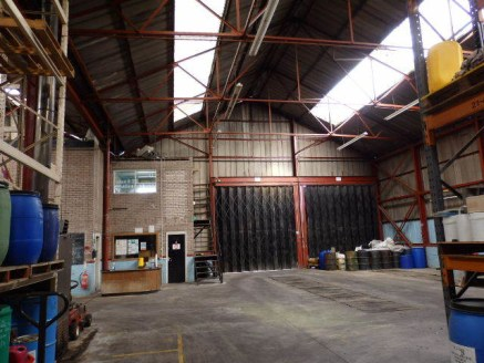 Detached industrial unit with adjoining two storey office block and single storey side extension.<br>Externally, the site provides extensive car parking and open storage land.<br><br>The property is available by way of a new full repairing and insuri...